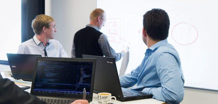 COMPANY-X MEN AT WORK: Senior developer Marcel van de Steeg explains a concept to colleagues Ryan O'Connor, left, and Jason Kelly.