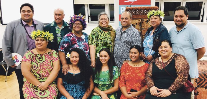 Minister for Pacific Peoples Aupito Tofae Su'a William Sio, standing, third from right, at Link House for the first of a series of nationwide meetings.