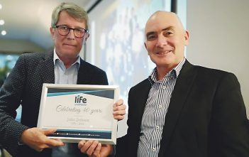 Chair John Dobson, left, receives a 40th anniversary certificate from chief executive Mark Brown.