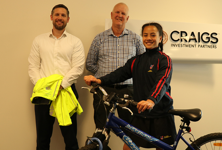 Steve Laurie (left) and David Armstrong (right) surprised Kailani with a bike and equipment to help her get to training.