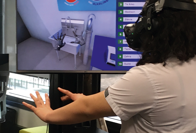 VIRTUAL REALITY: A Hamilton Girls' High School student washes her hands in a virtual reality dairy shed.