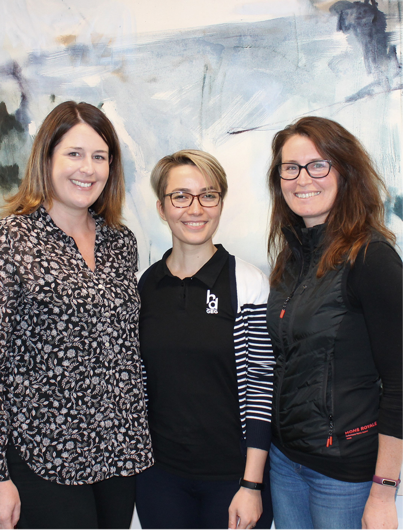 Kim Burgess, Shima Sheybani Aghdam and Emily Cleland. The oil painting behind them by Amanda Watson is one of several Urban Homes are displaying.