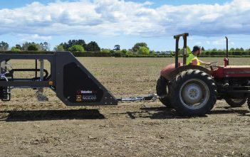 Robotic asparagus harvester version 1.5 being pulled by a tractor